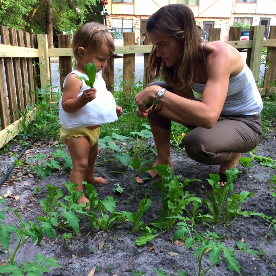 My little girl and I in the Arugula patch