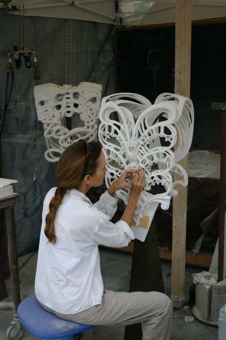 Elizabeth Working on a sculpture - via KPBS.org